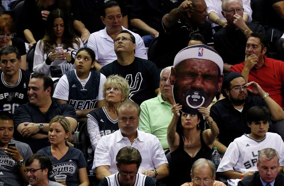 SAN ANTONIO, TX - JUNE 08:  A San Antonio Spurs fan holds up a sign against the Miami Heat during Game Two of the 2014 NBA Finals at the AT&T Center on June 8, 2014 in San Antonio, Texas. NOTE TO USER: User expressly acknowledges and agrees that, by downloading and or using this photograph, User is consenting to the terms and conditions of the Getty Images License Agreement.  (Photo by Chris Covatta/Getty Images) ORG XMIT: 495643413 Photo: Chris Covatta / 2014 Getty Images