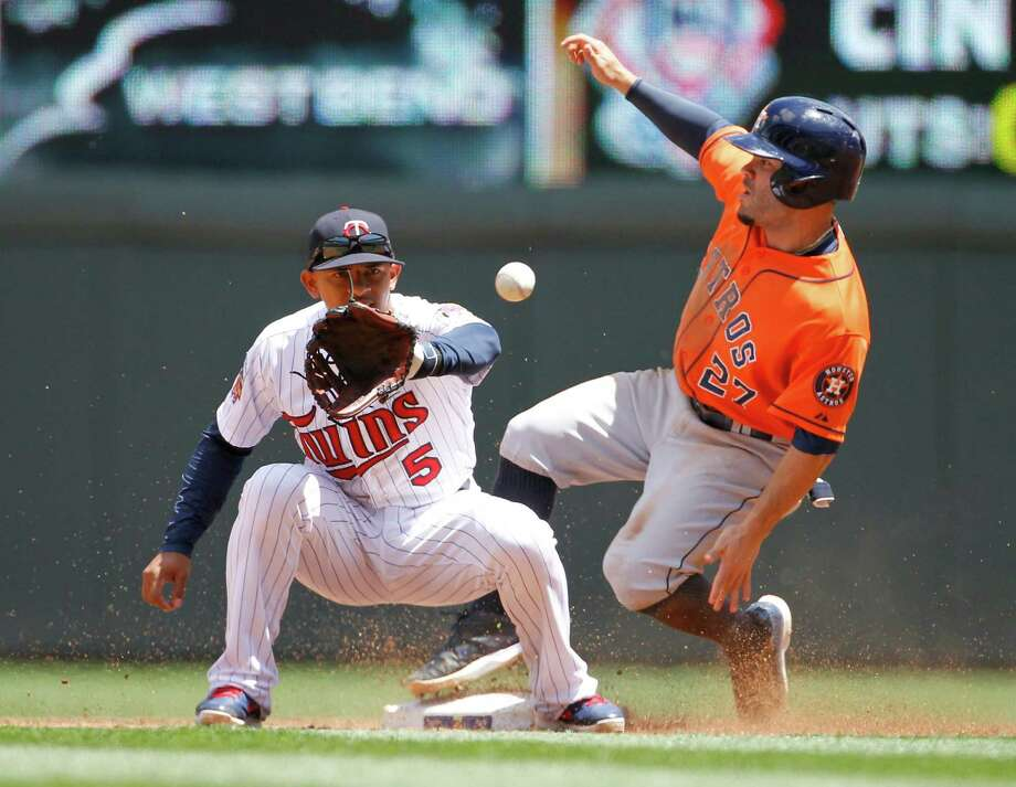 The Astros' Jose Altuve easily beats the throw to Twins shortstop Eduardo Escobar for his AL-leading 23th stolen base in the third inning Sunday. Photo: Ann Heisenfelt, FRE / FR13069 AP