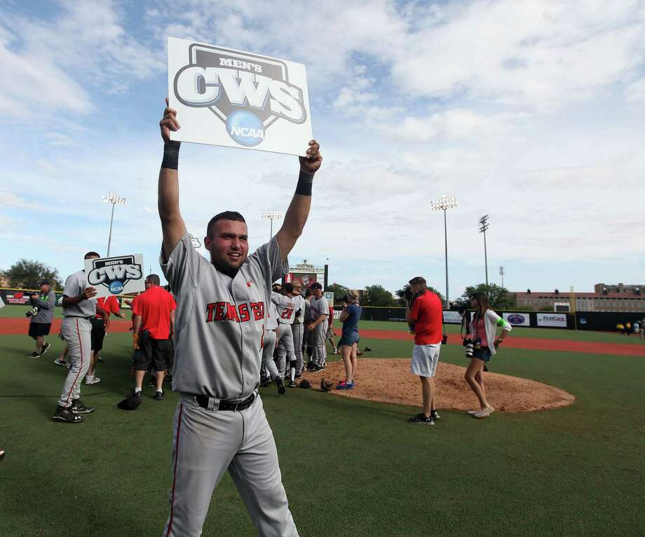As his teammates rejoice, Eric Gutierrez holds the sign of the new times for Texas Tech baseball after the Red Raiders wrapped up their first trip to the College World Series on Sunday. Photo: Shannon Wilson, MBI / Lubbock Avalanche-Journal
