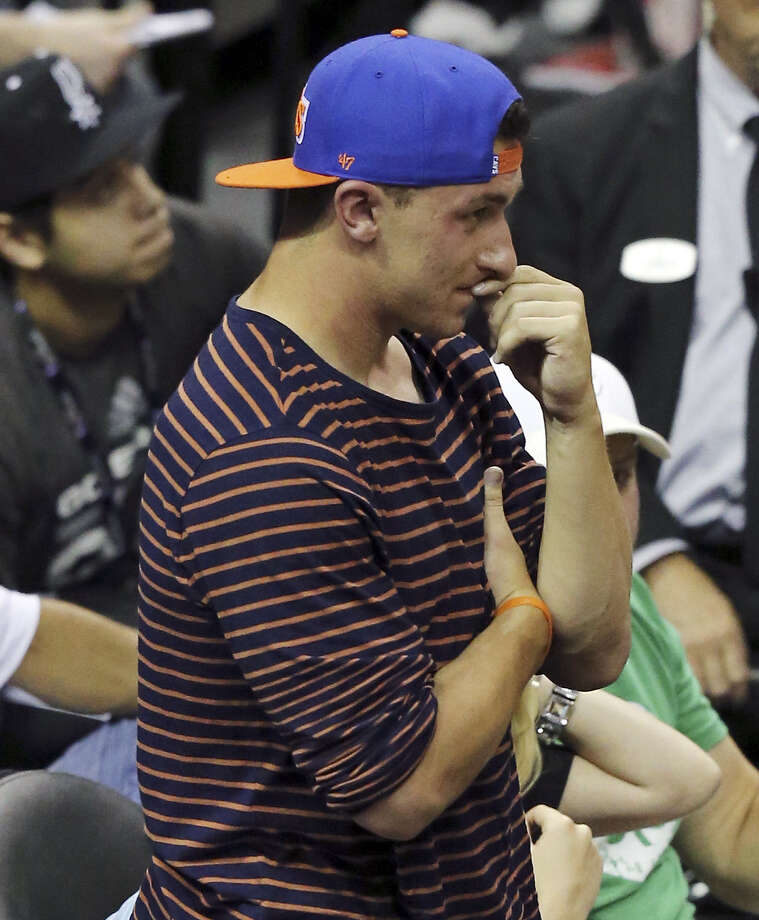 Johnny Manziel takes in the sights during second half action in Game 2 of the NBA Finals between the San Antonio Spurs and Miami Heat Sunday June 8, 2014 at the AT&T Center. Photo: Edward A. Ornelas / San Antonio Express-News / © 2014 San Antonio Express-News