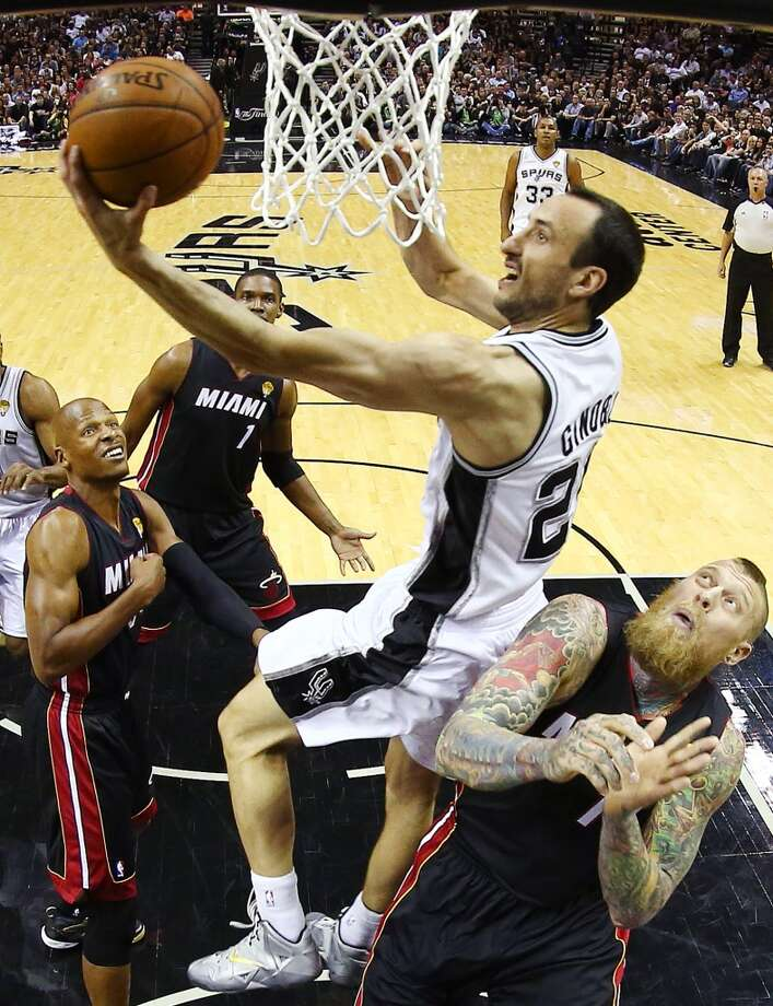 Manu Ginobili shoots over Chris Andersen, right, as guard Ray Allen, left, looks on during Game 2. Photo: Andy Lyons, Associated Press
