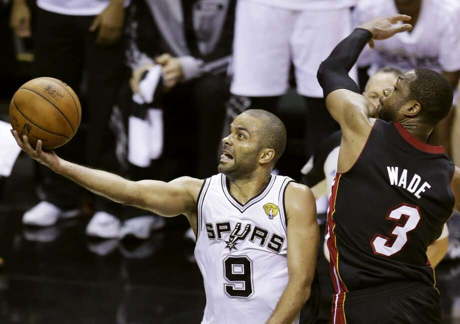 Tony Parker shoots against Dwyane Wade during Game 2. Photo: Tony Gutierrez, Associated Press