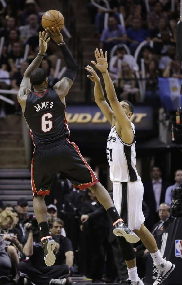 LeBron James shoots as Tim Duncan defends during Game 2. Photo: Eric Gay, Associated Press