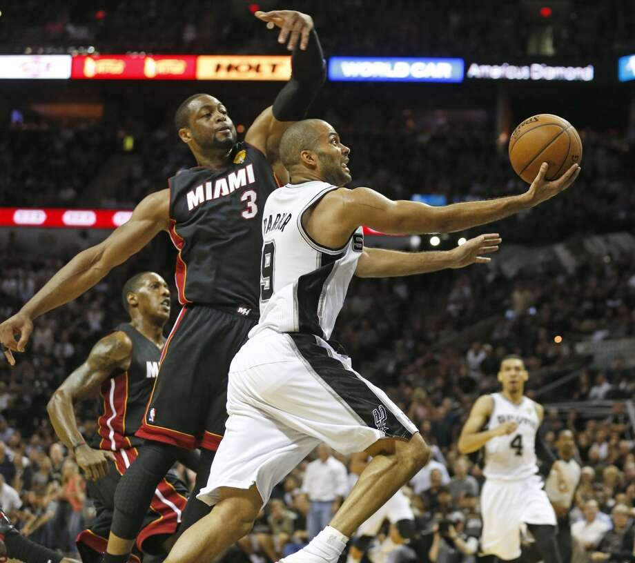 Dwyane Wade defends against Tony Parker during Game 2. Photo: Al Diaz, McClatchy-Tribune News Service