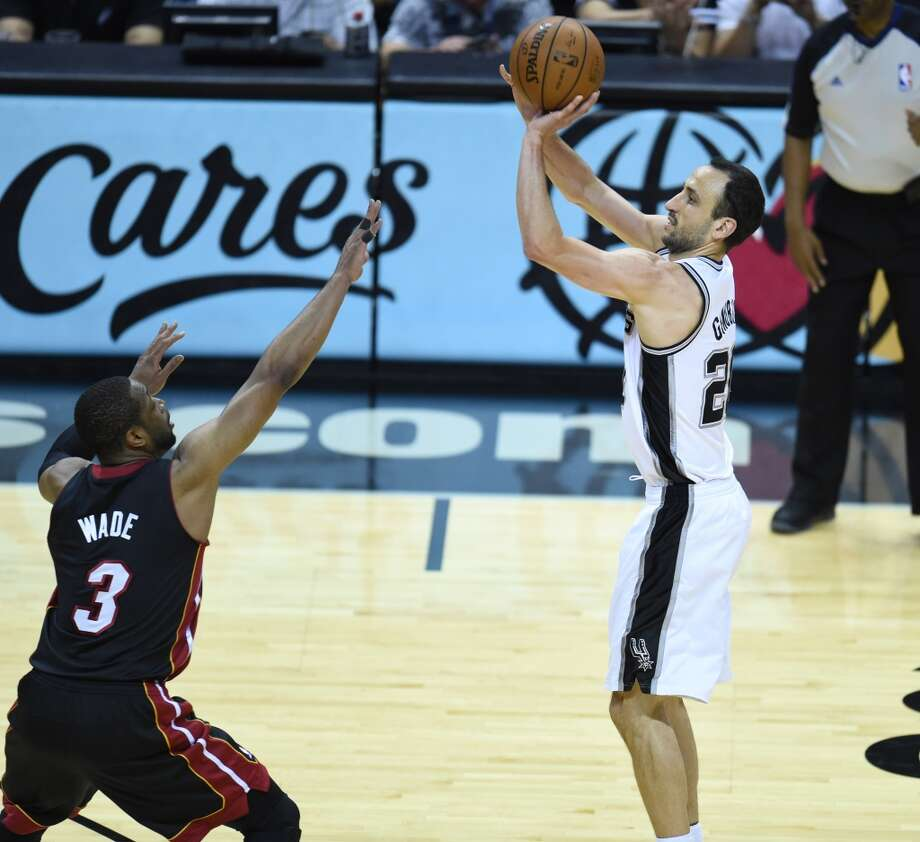 Manu Ginobili shoots over Dwyane Wade during Game 2. Photo: ROBYN BECK, AFP/Getty Images
