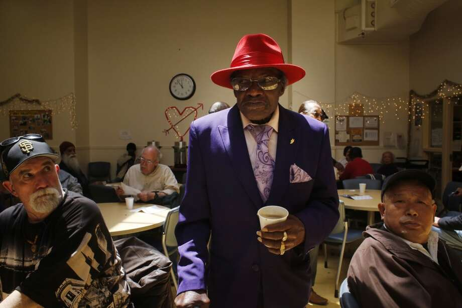 Dressed in his best suit, Claude Holman walks through the lunch room at the Curry Senior Center in San Francisco, Calif. Photo: Mike Kepka, The Chronicle