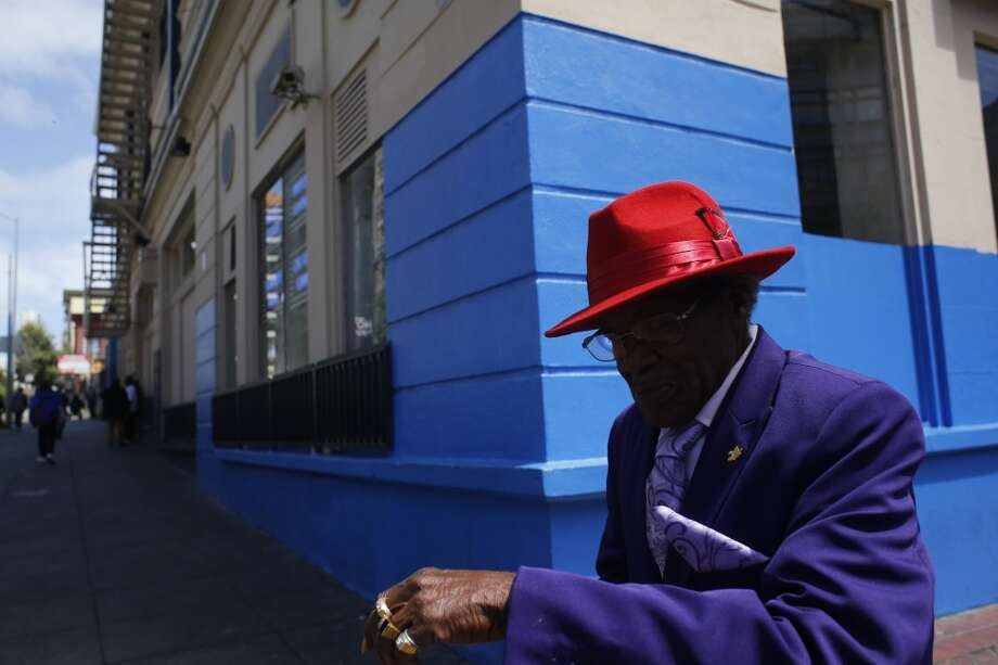 Dressed in his best suit, Claude Holman walks through the Tenderloin in San Francisco, Calif. Photo: Mike Kepka, The Chronicle