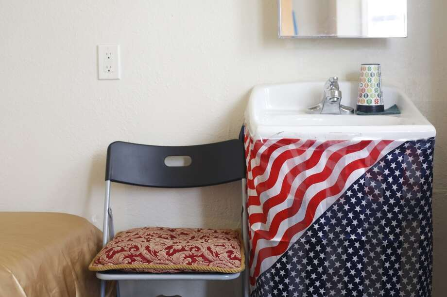Claude Holman in-room sink is neatened up with a plastic American flag in San Francisco, Calif. Photo: Mike Kepka, The Chronicle