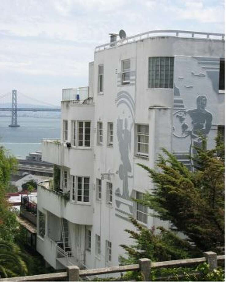 """The Malloch Building, 1360 Montgomery St.The Telegraph Hill art-deco building was where Lauren Bacall sheltered Humphrey Bogart in the film noir classic """"Dark Passage."""" Today, residents put a Bogart cutout in the window of No. 10, the apartment used in the movie. Photo: John King, The Chronicle"""