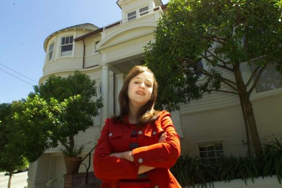 """2640 Steiner, Pacific HeightsThis large San Francisco Victorian was the family's home in """"Mrs. Doubtfire,"""" directed by S.F. resident Chris Columbus. Shown is star Mara Wilson there in 2000. Photo: Brant Ward, The Chronicle"""