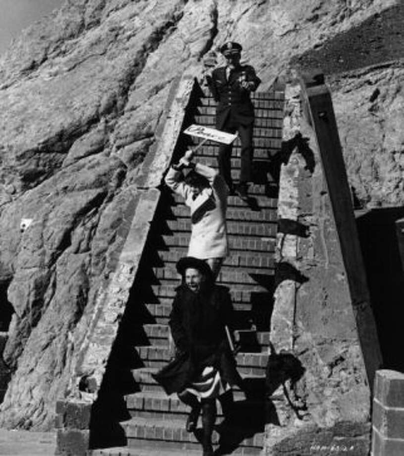 "Sutro Baths    In ""Harold and Maude,"" the pair stage a Vietnam war protest and chase here. Maude falls down a hole, which is now cemented over. Photo: Michael Ochs Archives, Getty Images"