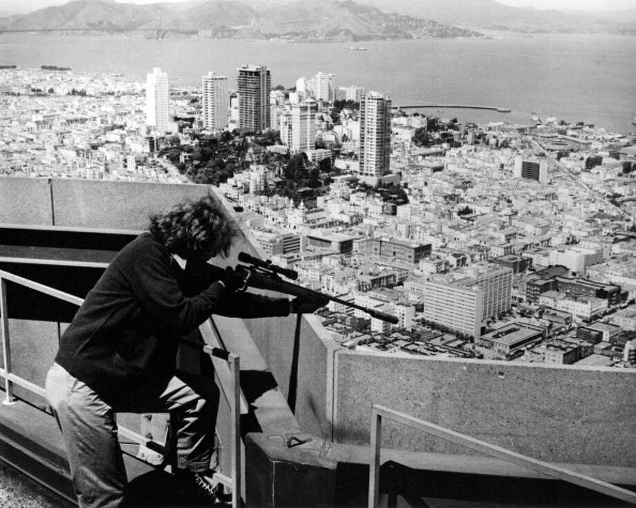 """555 California St., the Financial DistrictThe former Bank of America building was the tallest in S.F. when it was used in the opening scene of """"Dirty Harry"""" (pictured). The exterior was also used as the tower in """"The Towering Inferno."""" Photo: Silver Screen Collection, Getty Images / 2013 Silver Screen Collection"""