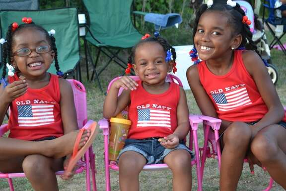 Aniya, Alaya and Jaiyla enjoy the Fourth of July program at Missouri City.