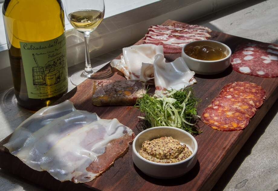 The medium Charcuterie Board with a glass of Calvados at Trou Normand in San Francisco, Calif., is seen on Monday, June 2nd 2014. Photo: Special To The Chronicle