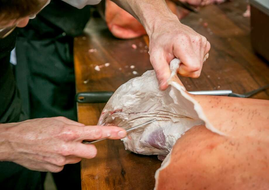 Chef Salvatore Cracco butchers a pig at Trou Normand in San Francisco, Calif., on Monday, June 2nd 2014. Photo: Special To The Chronicle