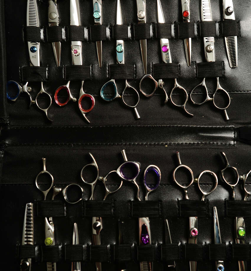 Sharpened and buffed shears for sale sit in a carrying case at the Harrisons' home on Wednesday afternoon. Wendell and Cindy Harrison have been running Ideal Edge, a shear-sharpening and sales business, for more than a year. The pair cater to salons across the Golden Triangle and beyond. Photo taken Wednesday 6/4/14 Jake Daniels/@JakeD_in_SETX Photo: Jake Daniels / ©2014 The Beaumont Enterprise/Jake Daniels