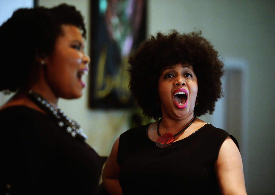 "Ashley Renee Watkins, left, and Olanna Goudeau rehearse at Grace Church of the Nazarene on Friday afternoon. Goudeau, originally from Port Arthur, and Watkins, a native of New Orleans, impressed the crowds and judges of NBC's ""America's Got Talent"" with their operatic performance in November. They will perform at the church on Saturday afternoon. Photo taken Friday 6/6/14 Jake Daniels/@JakeD_in_SETX Photo: Jake Daniels / ©2014 The Beaumont Enterprise/Jake Daniels"