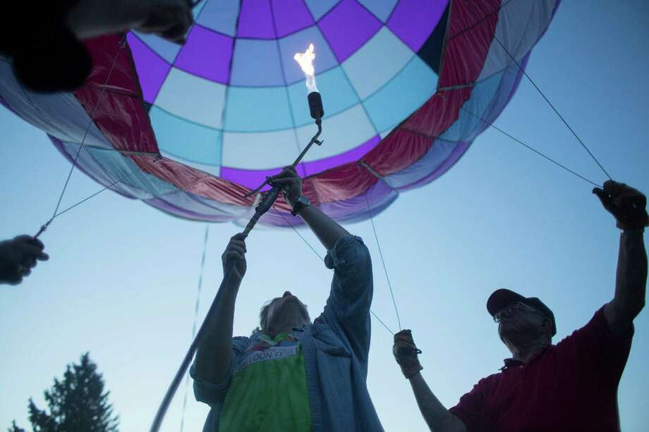 Penny Mills, center, inflates her hot air balloon during the Cambridge Balloon Festival on Saturday, June 7, 2014 in Cambridge, N.Y. (Tom Brenner/ Special to the Times Union) Photo: Tom Brenner / ©Tom Brenner/ Albany Times Union