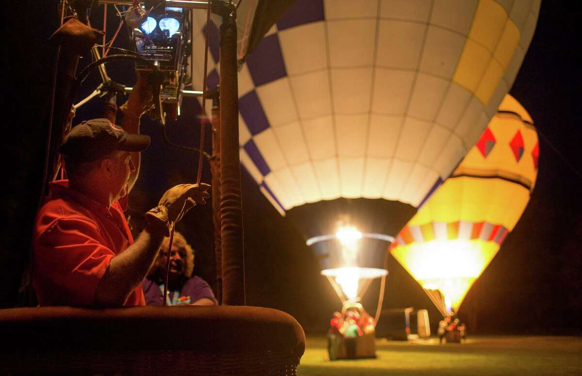 Glen Horton watches other balloon pilots as they illuminate their balloons using propane during the Cambridge Balloon Festival Glow Show on Saturday, June 7, 2014 in Cambridge, N.Y. (Tom Brenner/ Special to the Times Union)