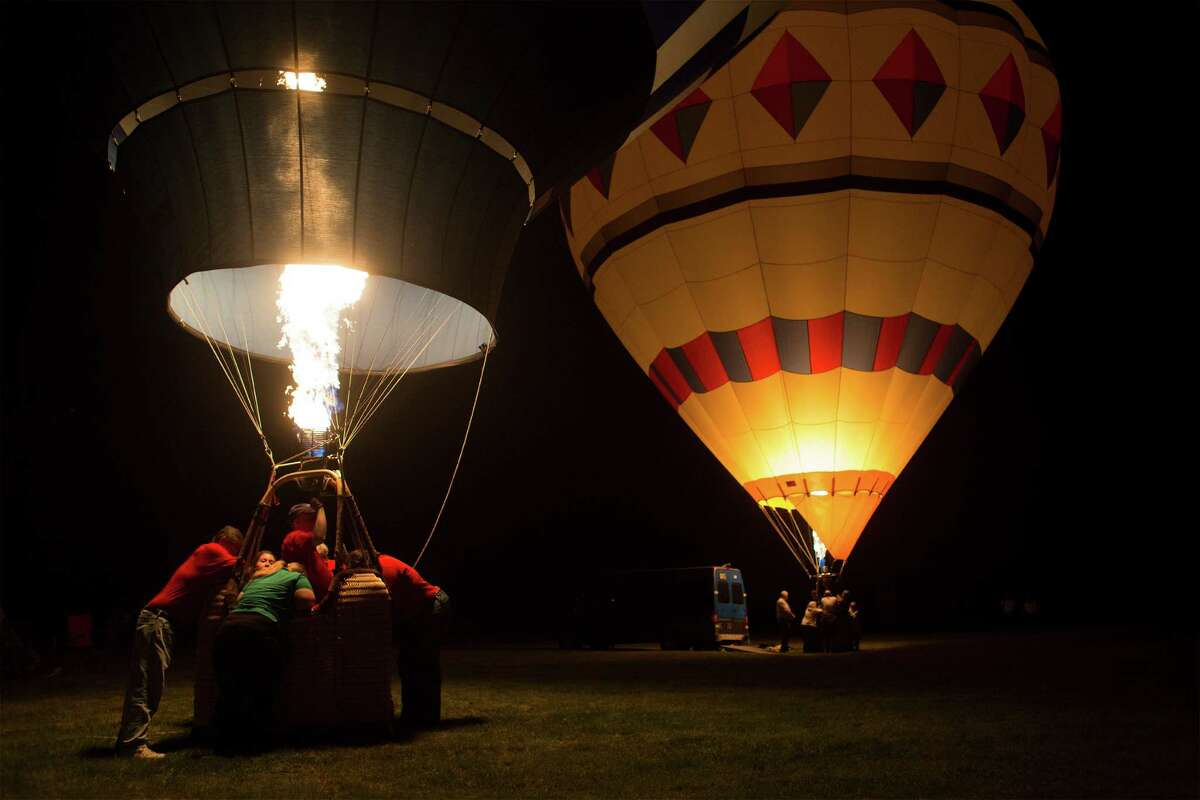 Hundreds of people from the area gathered to watch hot air balloons illuminated with propane during the Cambridge Balloon festival Glow Show on Saturday, June 7, 2014 in Cambridge, N.Y. (Tom Brenner/ Special to the Times Union)