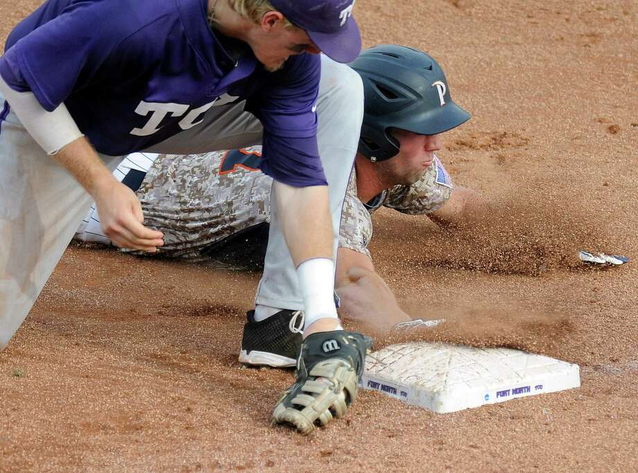 Pepperdine's Aaron Brown slides into first base in front of the tag from TCU infielder Kevin Cron, left, in the fourth inning of an NCAA college baseball tournament Super Regional game, Sunday, June 8, 2014, in Fort Worth, Texas. (AP Photo/Matt Strasen) Photo: Matt Strasen, Associated Press / FR170476 AP
