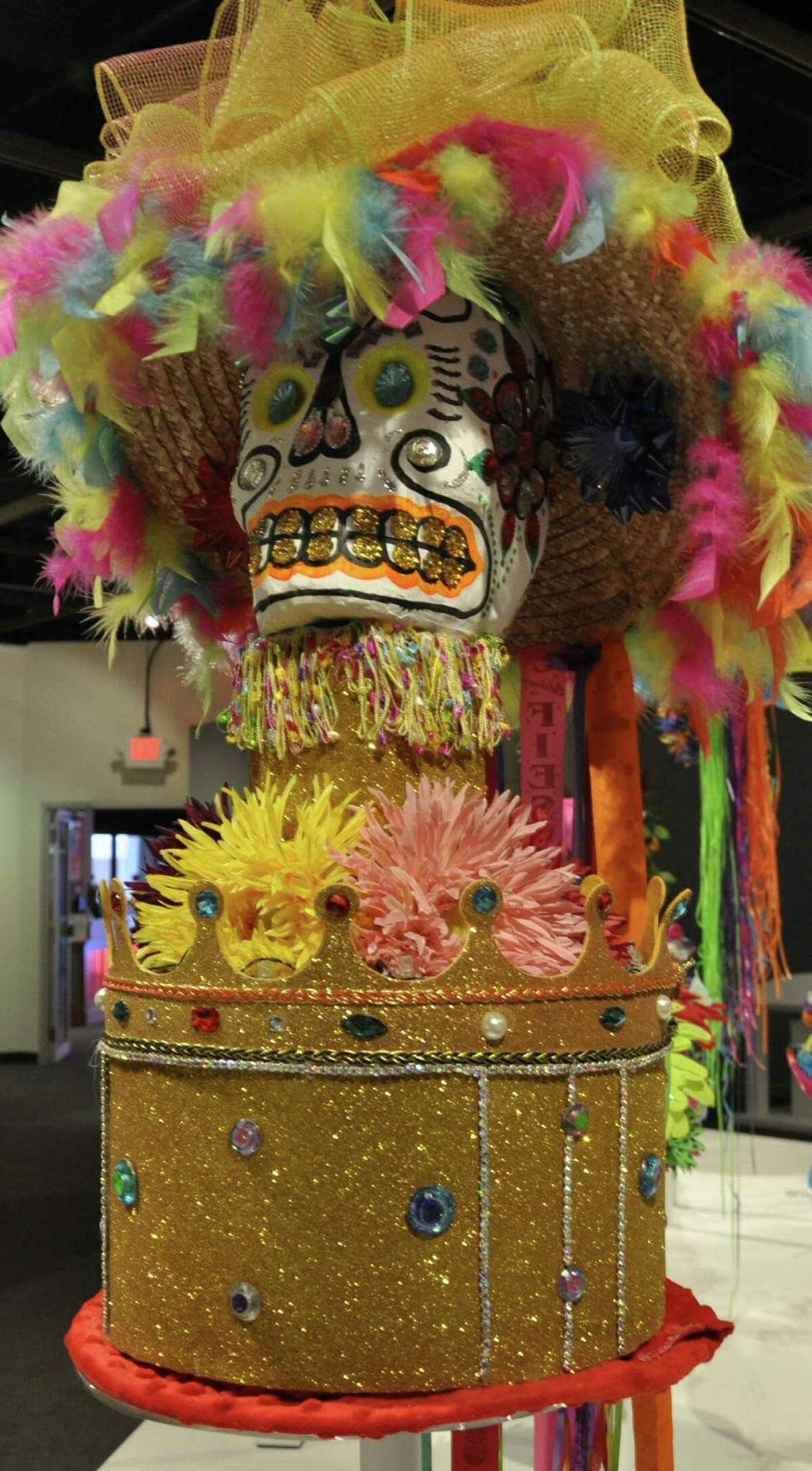 """Mike Taylor created this hat called King hat of Hats that is on display at the Institute of Texan Cultures """"Hats Off to Fiesta"""" first-ever hat exhibit that runs until July 6. he deconstructs his hat from the previous year and makes something new using bits and pieces of the previous hat."""