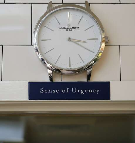 "A ""Sense of Urgency"" sign hangs in all of Thomas Keller's kitchens reminding his staff to go to work everyday prepared and ready to serve with speed but also invested with a sense of importance. Photo: Russell Yip, The Chronicle"