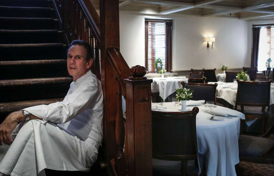 Chef Thomas Keller sits on the steps to the upstairs dining room of The French Laundry on Wednesday, April 16, 2014 in Yountville, Calif. Photo: Russell Yip, The Chronicle