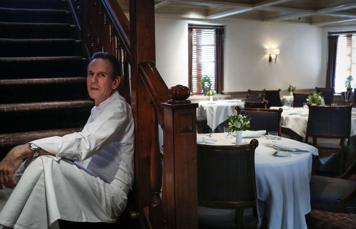 Chef Thomas Keller sits on the steps to the upstairs dining room of The French Laundry on Wednesday, April 16, 2014 in Yountville, Calif.