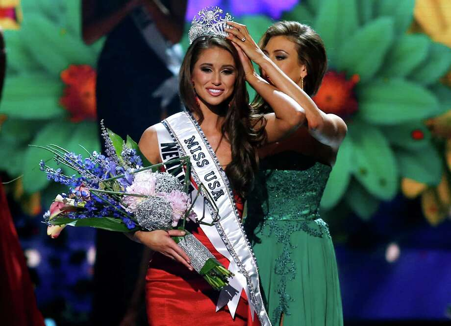 Miss Nevada USA Nia Sanchez is crowned Miss USA during the pageant in Baton Rouge, La., Sunday, June 8, 2014. Photo: Jonathan Bachman, AP / FR170615 AP