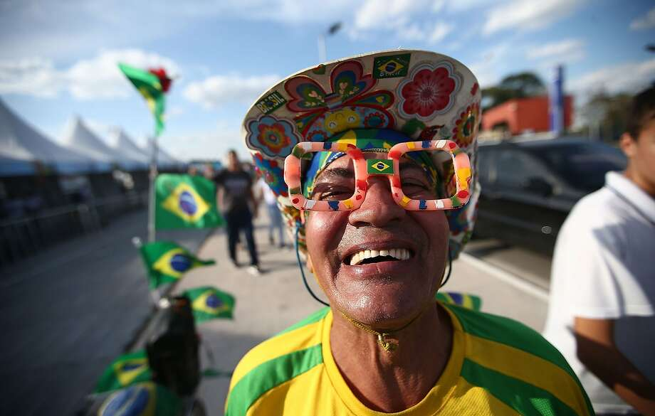A Brazil fans poses outside of opening ceremony rehearsals around Itaquerao stadium, also known as Arena de Sao Paulo and Arena Corinthians, on June 8, 2014 in Sao Paulo, Brazil. Hundreds of fans turned up at the stadium to take a peek on the final Sunday before the opening of the 2014 FIFA World Cup match on June 12 between Brazil and Croatia. Brazil has won five World Cups, more than any other nation.  Photo: Mario Tama, Getty Images
