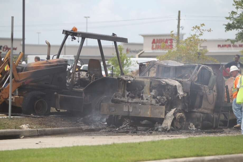 A gas line caught fire Monday, June 9, 2014 off the Gulf Freeway when it was reportedly struck by a backhoe being used on a nearby construction project. (Cody Duty | Houston Chronicle) Photo: Cody Duty ,  Houston Chronicle