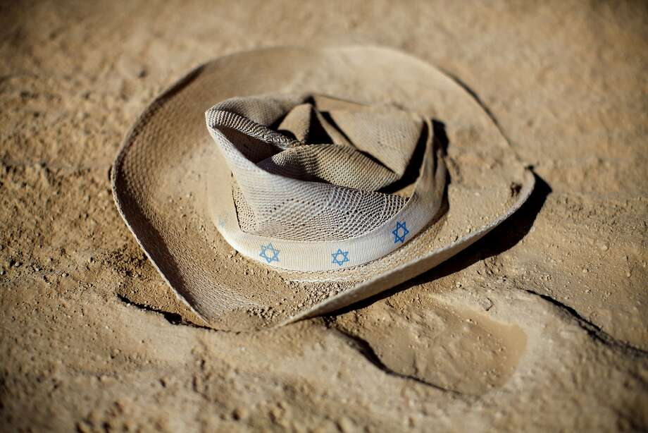 In this photo taken Friday, June 6, 2014, a hat with stars of david lays on the ground during Israel's first Midburn festival, modeled after the popular Burning Man festival held annually in the Black Rock Desert of Nevada, in the desert near the Israeli kibbutz of Sde Boker. The festival took place a few miles southwest of the desert gravesite of Israel's founding father, David Ben-Gurion, who dreamed of making the Negev desert bloom _ though he probably didn't envisioned it blossoming with hula hoops and pyrotechnics. At the end, participants were told to remove their own trash and leave the desert without a trace.  Photo: Oded Balilty, Associated Press