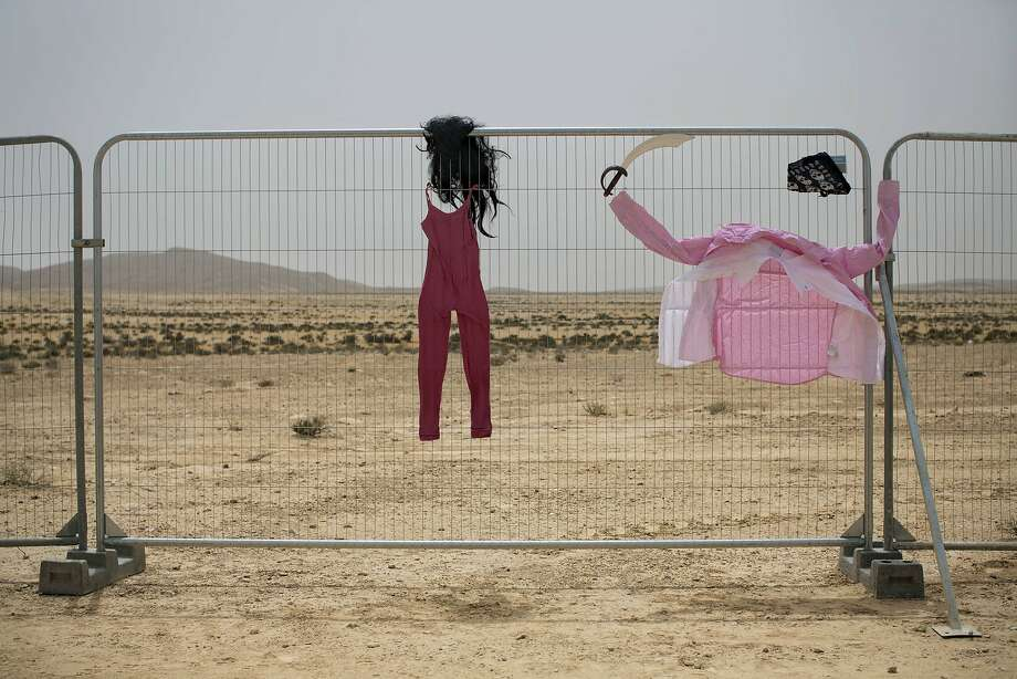 In this photo taken Wednesday, June 4, 2014, costumes hang on a fence at the first Israel's Midburn festival, modeled after the popular Burning Man festival held annually in the Black Rock Desert of Nevada, in the desert near the Israeli kibbutz of Sde Boker. The festival took place a few miles southwest of the desert gravesite of Israel's founding father, David Ben-Gurion, who dreamed of making the Negev desert bloom _ though he probably didn't envisioned it blossoming with hula hoops and pyrotechnics. At the end, participants were told to remove their own trash and leave the desert without a trace. Photo: Oded Balilty, Associated Press