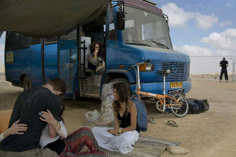"""In this photo taken Saturday, June 7, 2014, Israelis sits under the shade during Israel's first Midburn festival, modeled after the popular Burning Man festival held annually in the Black Rock Desert of Nevada, in the desert near the Israeli kibbutz of Sde Boker. For five days, participants, mostly Israelis ,created a temporary city dedicated to creativity, communal living, and what the festival calls """"radical self-expression."""" Photo: Oded Balilty, Associated Press"""