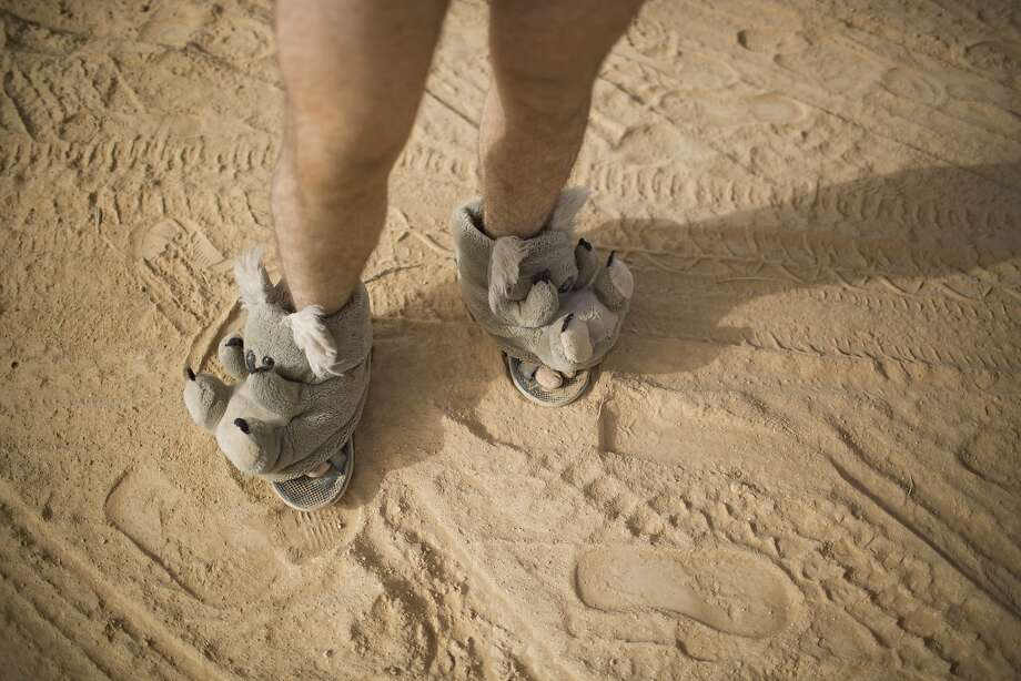 "In this photo taken Thursday, June 5, 2014, an Israeli man walks in house slippers during Israel's first Midburn festival, modeled after the popular Burning Man festival held annually in the Black Rock Desert of Nevada, in the desert near the Israeli kibbutz of Sde Boker. For five days, participants mostly Israelis created a temporary city dedicated to creativity, communal living, and what the festival calls ""radical self-expression."" Photo: Oded Balilty, Associated Press"