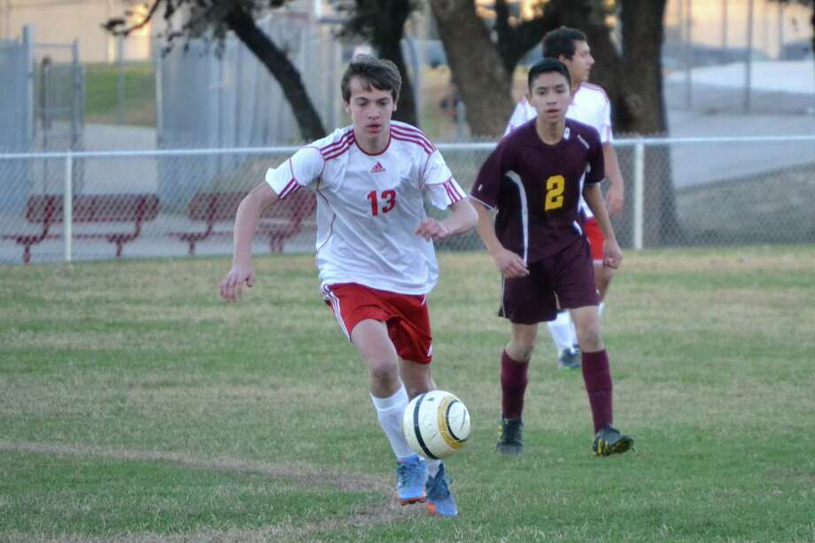 Max Schmuelling, center, an exchange student from Germany, was on the Taft High School soccer team, and says participating on the team was his favorite part of his year in San Antonio. Photo: Courtesy / Laura Higgs