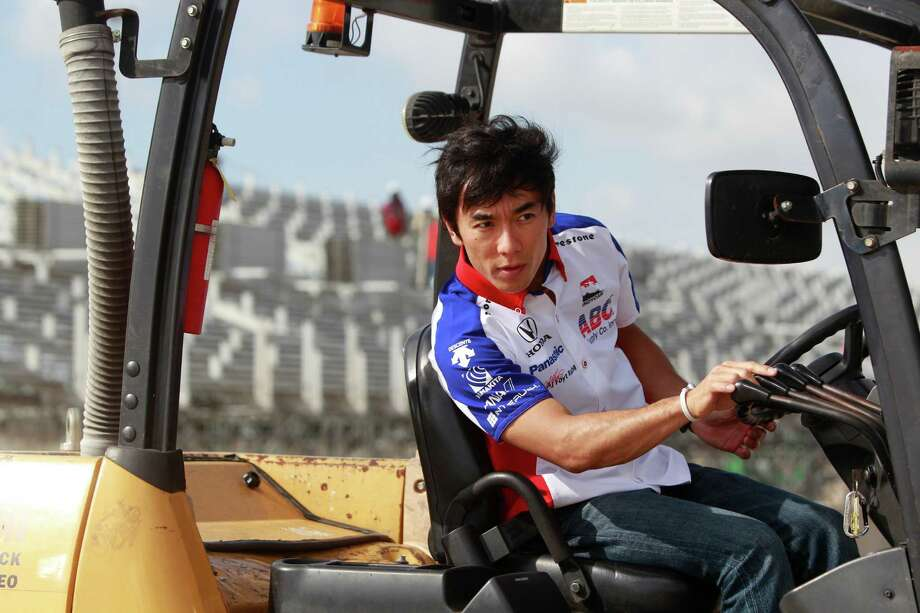 IndyCar driver Takuma Sato moves a concrete barrier with a fork lift during a Grand Prix of Houston media event at NRG Park Monday, June 9, 2014, in Houston. Photo: Melissa Phillip, Houston Chronicle / © 2014  Houston Chronicle