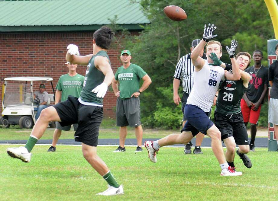 Zac Richardson deflects a pass as The Woodlands' Lex Trauffler defends the Clemens receiver during the 7 on 7 state qualifying football tournament at The Woodlands High School.  Photo: David Hopper, For The Chronicle / freelance