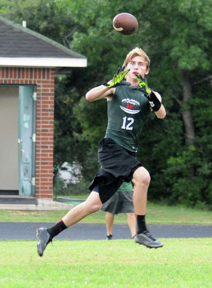 The Woodlands Hunter Moore catches a TD pass during the 7 on 7 state qualifying football tournament at The Woodlands High School. The Highlanders' team qualified for the state tournament to be held next month in College Station. Photo: David Hopper, For The Chronicle / freelance