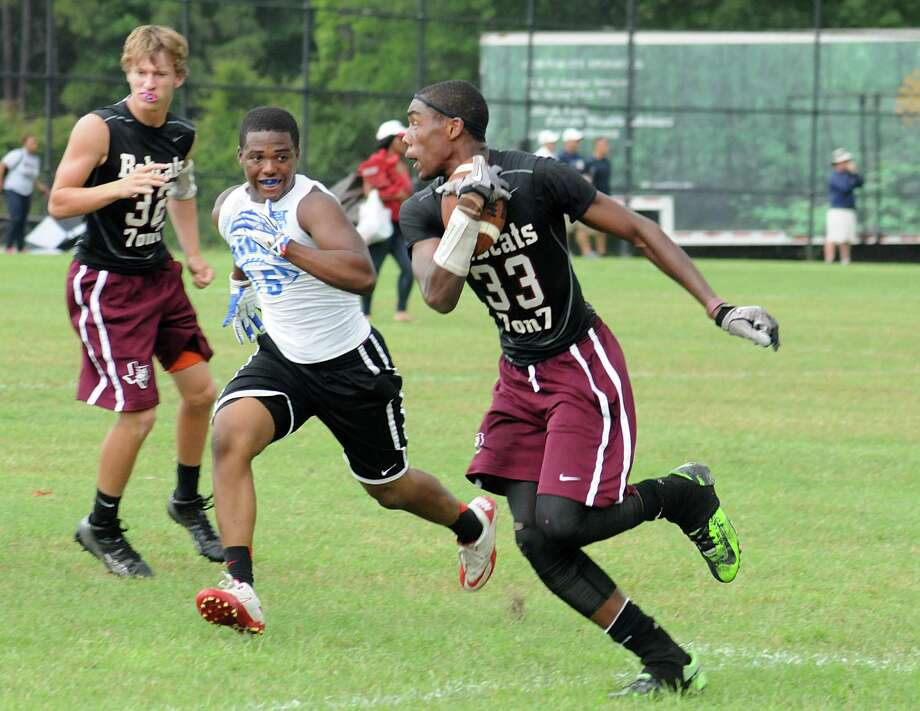Cypress Fairbank's Broderick Chambers runs after a reception, as Oak Ridge's Malik Pounds closes in during the 7 on 7 state qualifying football tournament at The Woodlands High School.  Photo: David Hopper, For The Chronicle / freelance