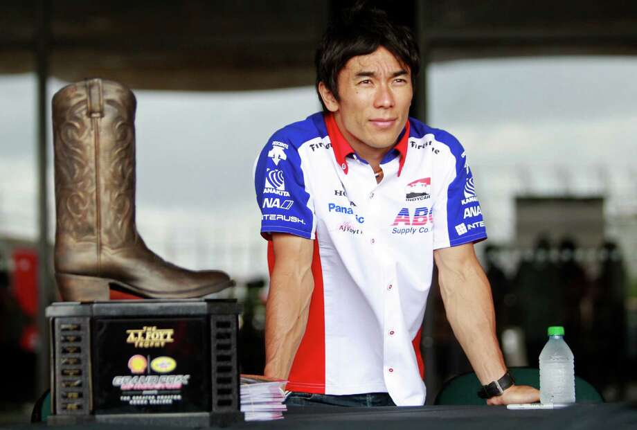 IndyCar driver Takuma Sato waits near the A.J. Foyt Grand Prix of Houston trophy to sign autographs during a Grand Prix of Houston media event at NRG Park Monday, June 9, 2014, in Houston. Photo: Melissa Phillip, Houston Chronicle / © 2014  Houston Chronicle