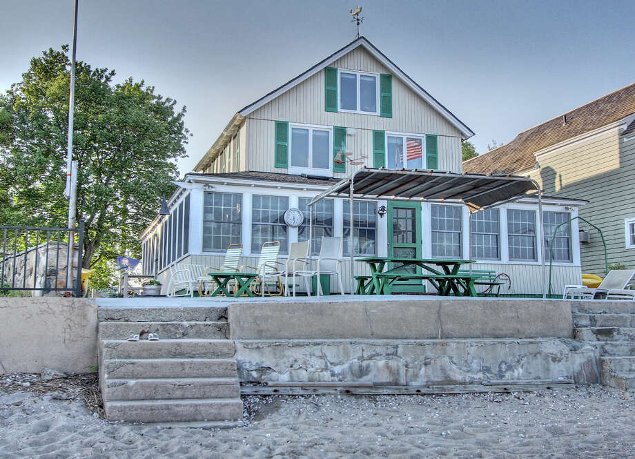 The house at 1361 Fairfield Beach Road is on the market for $1.5 million. Photo: Contributed Photo / Fairfield Citizen