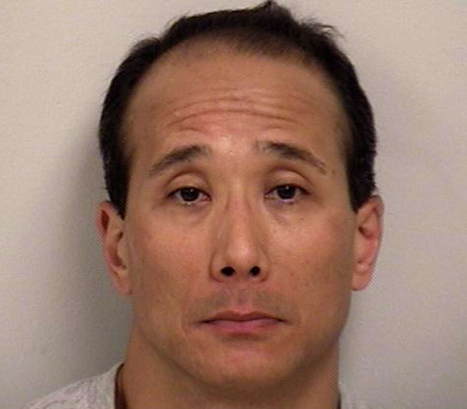 Boku Prince, 48, of Pound Ridge, N.Y., faces charges after police said he was discovered with more than five pounds of marijuana and $12,000 cash Saturday in the parking lot of the Westport Weston Health District. Photo: Westport Police Department / Westport News