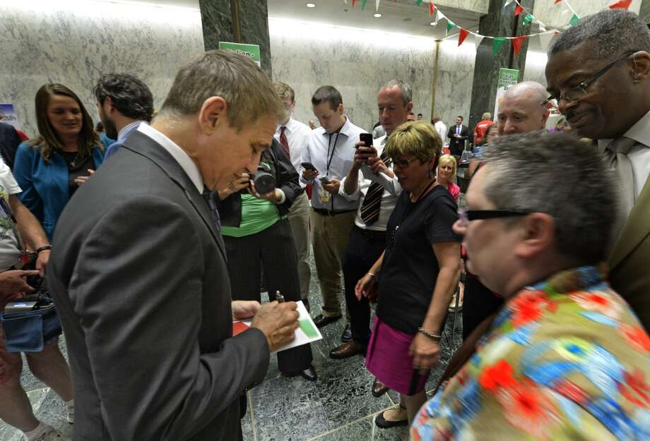 Actor Tony Danza signs autographs at the Italian festival in the well of the Legislative Office Building Monday morning June 9, 2014 before he received his honorarium from the Conference of Italian-American State Legislators in Albany, N.Y.      (Skip Dickstein / Times Union) Photo: SKIP DICKSTEIN, ALBANY TIMES UNION