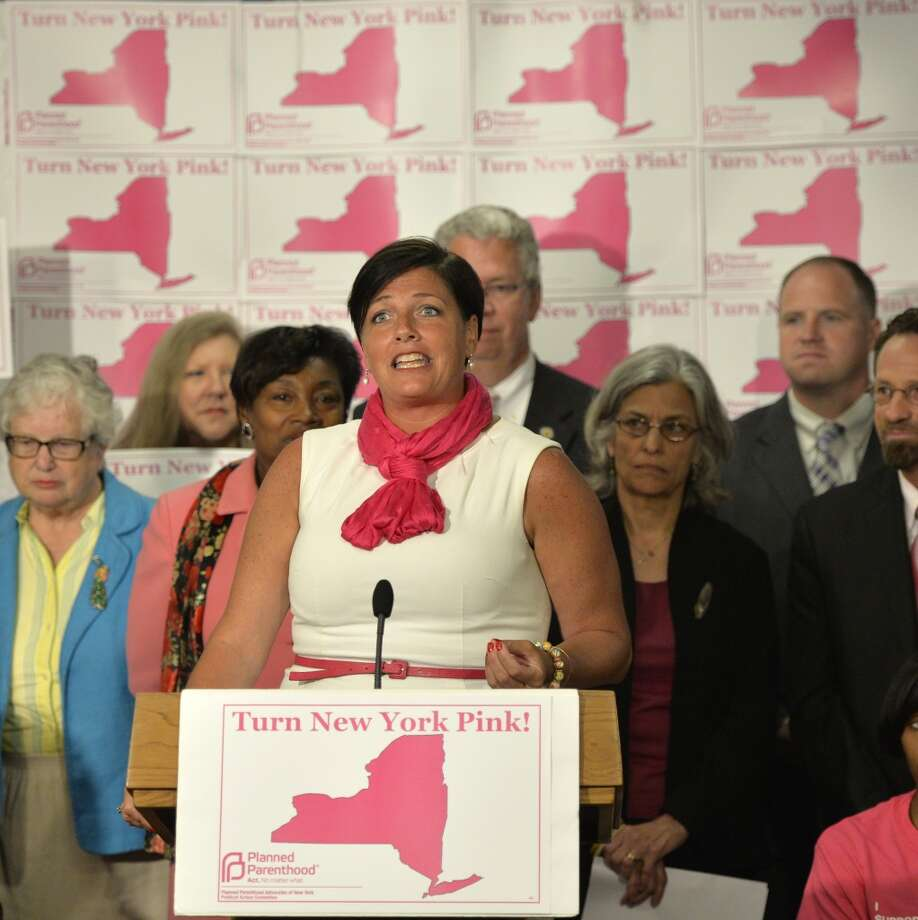 M. Tracey Brooks, president and CEO of Planned Parenthood Advocates of New York, at the podium announces a newly created Political Action Committee to support candidates across the state who affirm women's reproductive health rights during a press conference held Monday afternoon June 9, 2014 in Albany, N.Y.      (Skip Dickstein / Times Union) Photo: SKIP DICKSTEIN, ALBANY TIMES UNION
