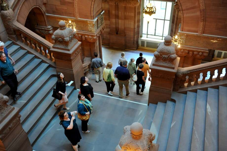History lovers descend the Million Dollar Staircase during a Civil War tour on Thursday, June 5, 2014, at the Capitol in Albany, N.Y. (Cindy Schultz / Times Union) Photo: Cindy Schultz, Albany Times Union
