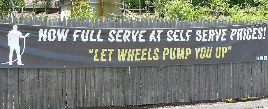 The Wheels station, 1096 Post Road, offers full service to its customers including pumping gas and washing windshields. Photo: Staff Photo/Gretchen Webster / Fairfield Citizen