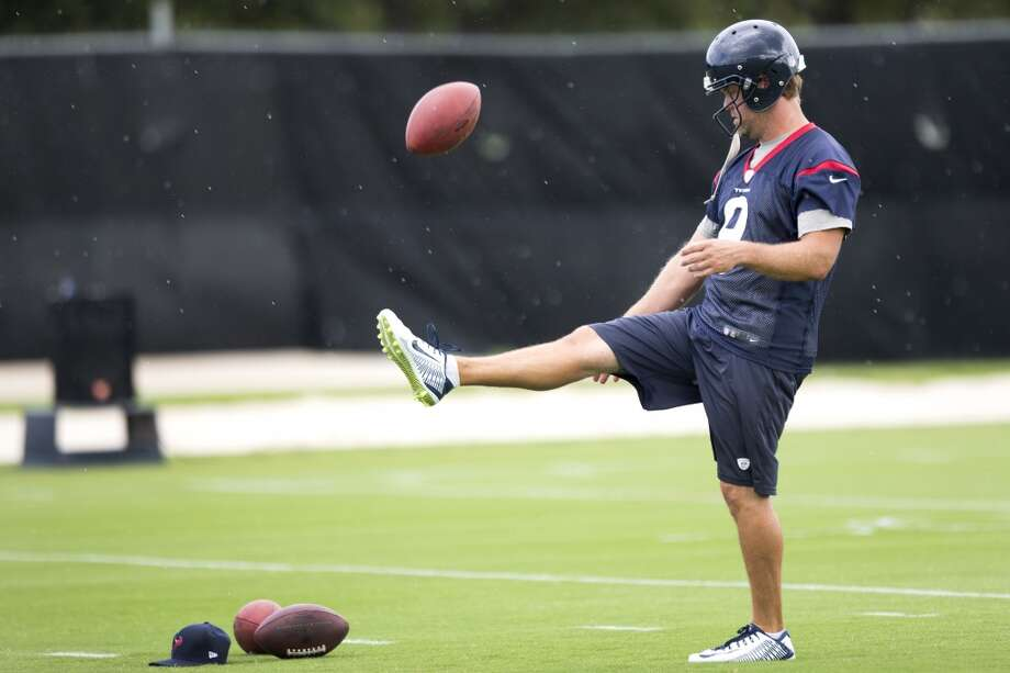 Texans punter Shane Lechler kicks the ball. Photo: Brett Coomer, Houston Chronicle