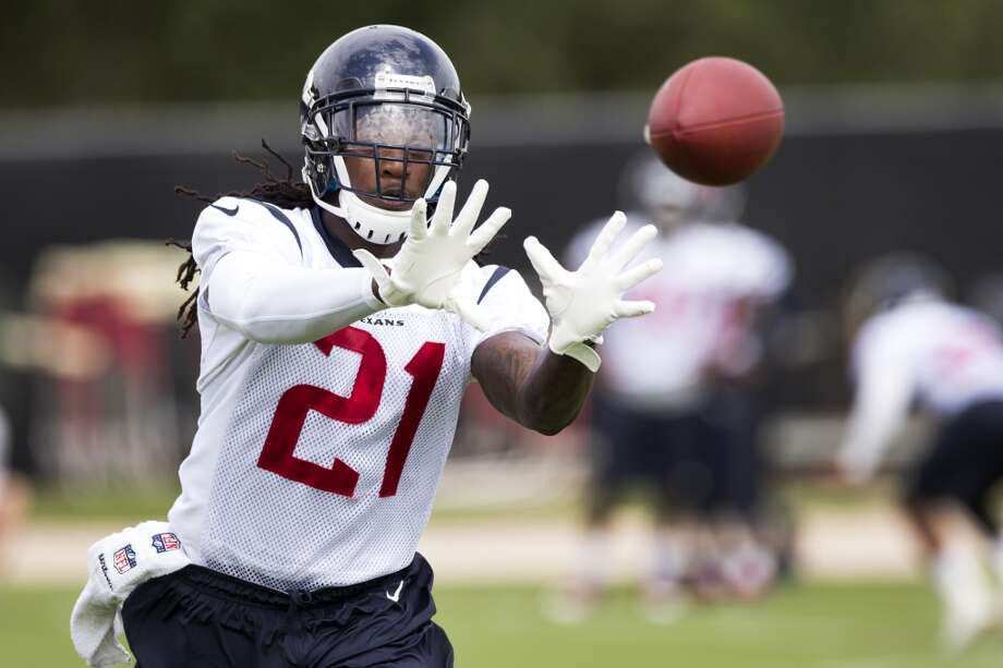 Texans safety Kendrick Lewis reaches out to catch a football. Photo: Brett Coomer, Houston Chronicle